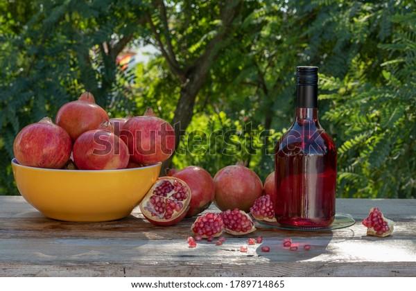 bottle-pomegranate-liquor-fruit-on-600w-