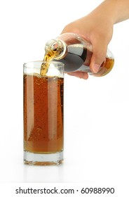 Bottle pouring tea drink over glass isolated over white