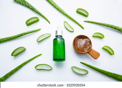 Bottle of products for spa or skin care cosmetic aloe vera gel and Aloe Vera leaves isolated on white background