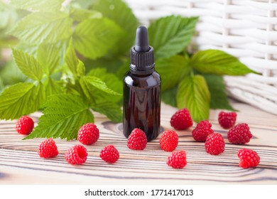 A bottle of raspberry seed oil with fresh fruit - beauty treatment
