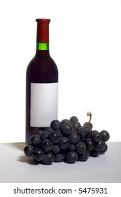 a bottle of red wine with blue grapes, on white
