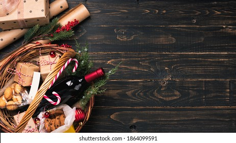 Bottle of red wine in Christmas basket.