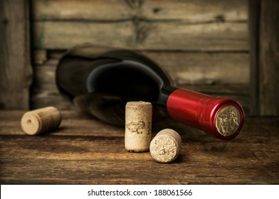 bottle of red wine with corks