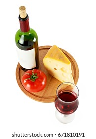 Bottle of red wine with wine glass cheese and tomato on wooden cutting board isolated on white background