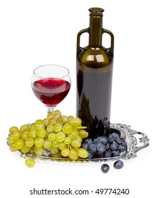 A bottle of red wine, glass and grapes on a white background - still life