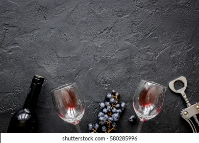 bottle of red wine with glasses on texture background top view mock-up