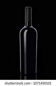 Bottle of red wine on black background