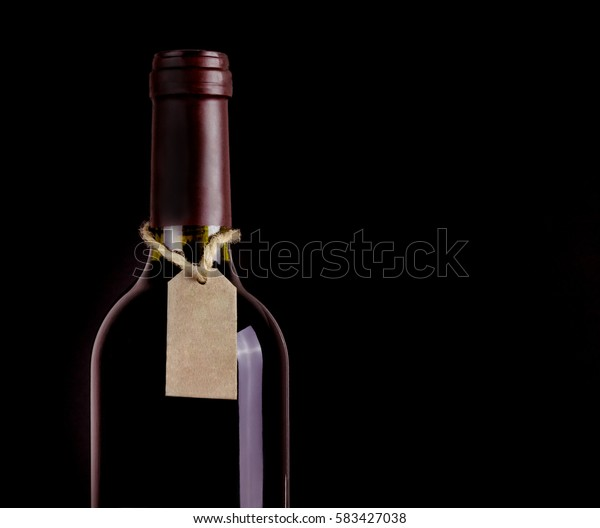 Bottle of red wine with a tag on rope.