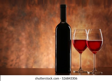 Bottle  of red wine with two glasses
