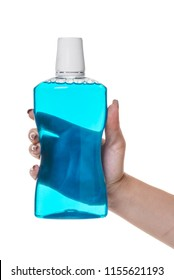 bottle with rinse aid for mouth in hand on white isolated background