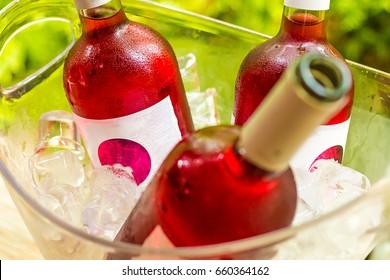 Bottle Of Rose Wine In Ice Bucket Outdoor Stock Photo