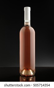 bottle of rose wine with no label