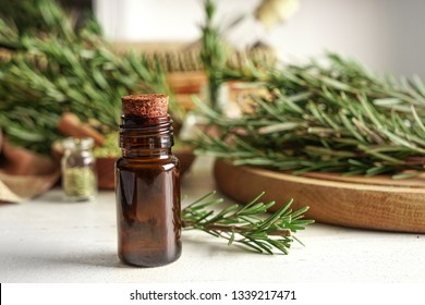 Bottle with rosemary oil on table