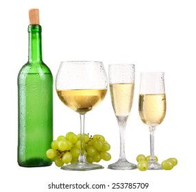 bottle, a row of white wine glasses with wine and grapes isolated on white background