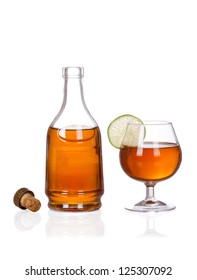 Bottle set. Cognac bottle and glass isolated on white