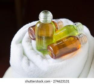 Bottle of shampoo on a towel