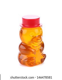 Bottle shaped like a bear and filled with honey