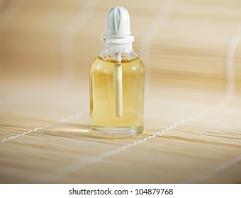 Bottle of spa oil on the bambuk background