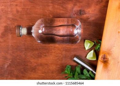 Bottle with strong alcohol on a wooden background