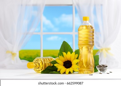 Bottle of sunflower oil on the table, window with field view in background