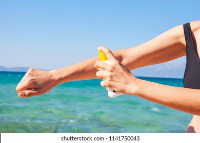Bottle of sunscreen lotion on tropical beach, Beach accessories and summer concept