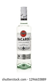 Bottle of superior white rum Bacardi Carta Blanca on a white background with reflection.