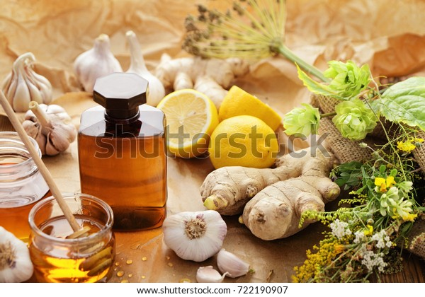 bottle of syrup, honey and herbs. alternative medicine
