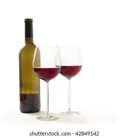 Bottle and two glasses with red wine and smooth shadow