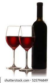 bottle and two  glasses of red wine  isolated on white background