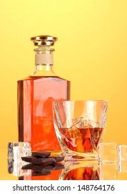 Bottle and two glasses of scotch whiskey, on color background