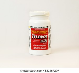 A bottle of Tylenol pain reliever pills isolated on white.