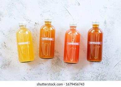 bottle of variety probiotic drink Kombucha on white cement background.