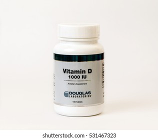 A bottle of vitamin D supplement isolated on white.