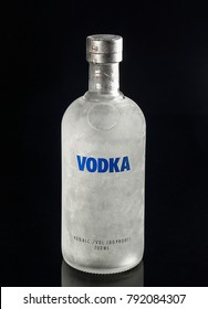 A bottle of vodka from the freezer on a black background
