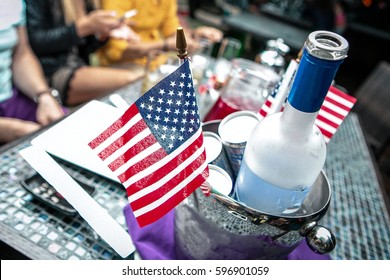 Bottle of vodka in an ice bucket on a table, Independence Day party