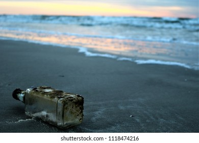 Bottle washed ashore on the beach