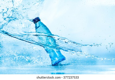 Bottle of water splash on a blue background