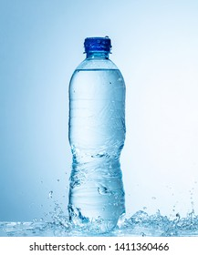 bottle of water with splashes
