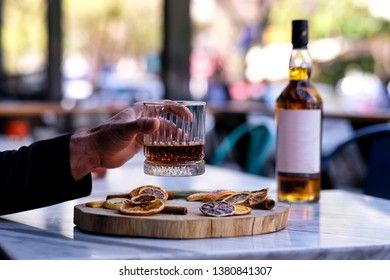 A bottle of whiskey. Drink a glass of whiskey alcohol on the presentation board
