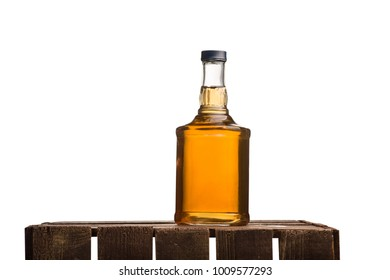 A bottle of whiskey on a box with an isolated background