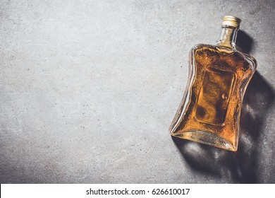 Bottle of whiskey on gray stone table