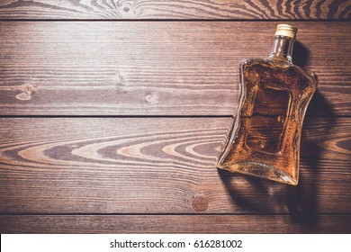 Bottle of whiskey on wooden table