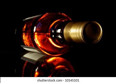 Bottle of whisky with black crisp background