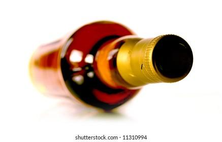 Bottle of whisky on white background