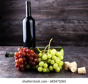 Bottle of white and red wine, grape and corks