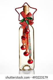 Bottle of white wine with christmas decoration  on white background