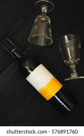 Bottle of wine  on black background with glasses