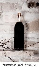 Bottle of wine on raw stones background