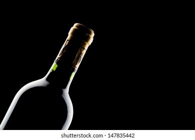 bottle of wine over black background