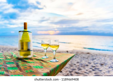 A bottle of wine and two glasses against the sea in Moalboal, Cebu, Philippines. With selective focus